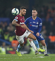West Ham United's Ryan Fredericks and Chelsea's Eden Hazard <br /> <br /> Photographer Rob Newell/CameraSport<br /> <br /> The Premier League - Chelsea v West Ham United - Monday 8th April 2019 - Stamford Bridge - London<br /> <br /> World Copyright © 2019 CameraSport. All rights reserved. 43 Linden Ave. Countesthorpe. Leicester. England. LE8 5PG - Tel: +44 (0) 116 277 4147 - admin@camerasport.com - www.camerasport.com
