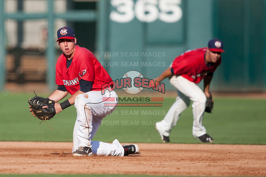 Oklahoma City RedHawks first baseman Matt Duffy (4) fields the ball during the Pacific League against the Colorado Springs Sky Sox game at the Chickasaw Bricktown Ballpark on August 3, 2014 in Oklahoma City, Oklahoma.  The RedHawks defeated the Sky Sox 8-1.  (William Purnell/Four Seam Images)