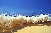 Water rushing to shore at ehukai beach park on the north shore of Oahu