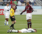 7 April 2007: Colorado's Roberto Brown (19) discusses the play with referee Michael Kennedy (left) as United's Ben Olsen lies hurt. The Colorado Rapids defeated DC United 2-1 at Dick's Sporting Goods Park in Denver, Colorado in the opening game of the MLS regular season.