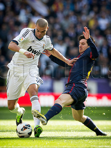 02.03.203 Madrid, Spain. Defender Pepe of Real Madrid (L) takes on Leo Messi of Barcelona during the Spanish La Liga game between Real Madrid and Barcelona from the Santiago Bernabeu.