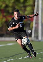 Oct 29, 2014; Orange, CA, USA; Occidental College Tigers midfielder Alessandro Carotenuto (8) against the Chapman College Panthers. Photo by Kirby Lee
