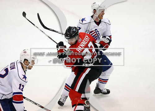 February 22nd 2008:  Josh Hennessy (23) of the Binghamton Senators battles with Dan Collins (17) during a game vs. the Rochester Amerks at Blue Cross Arena at the War Memorial in Rochester, NY.  The Senators defeated the Amerks 4-0.   Photo copyright Mike Janes Photography