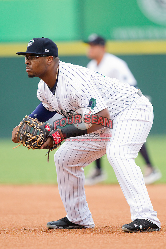 Charlotte Knights first baseman Mike McDade (17) on defense against the Lehigh Valley IronPigs at Knights Stadium on August 6, 2013 in Fort Mill, South Carolina.  The IronPigs defeated the Knights 4-1.  (Brian Westerholt/Four Seam Images)