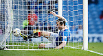 Jon Daly slides in to score the sixth goal for Rangers