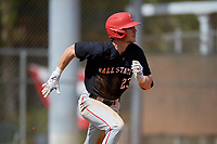 Ball State Cardinals right fielder Ross Messina (23) runs to first base during a game against the Saint Joseph's Hawks on March 9, 2019 at North Charlotte Regional Park in Port Charlotte, Florida.  Ball State defeated Saint Joseph's 7-5.  (Mike Janes/Four Seam Images)
