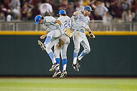 UCLA outfielders Christoph Bono (3), Brian Carroll (24) and Eric Filia (4) celebrate their victory in Game 1 of the 2013 Men's College World Series Finals against the Mississippi State Bulldogs on June 24, 2013 at TD Ameritrade Park in Omaha, Nebraska. The Bruins defeated the Bulldogs 3-1, taking a 1-0 lead in the best of 3 series. (Andrew Woolley/Four Seam Images)