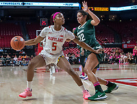 COLLEGE PARK, MD - FEBRUARY 03: Kaila Charles #5 of Maryland holds the ball away from Moira Joiner #22 of Michigan State during a game between Michigan State and Maryland at Xfinity Center on February 03, 2020 in College Park, Maryland.
