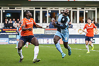 Magnus Okuonghae of Luton Town and Aaron Pierre of Wycombe Wanderers (centre) look for the ball during the Sky Bet League 2 match between Luton Town and Wycombe Wanderers at Kenilworth Road, Luton, England on 26 December 2015. Photo by David Horn.