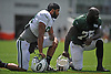 Austin Seferian-Jenkins #88 of the New York Jets, left, takes a knee alongside Anthony Johnson #75 during training camp at the Atlantic Health Jets Training Center in Florham Park, NJ on Friday, Aug. 4, 2017.
