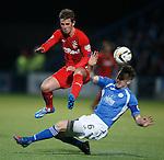 David Templeton jumps over the tackle of Chris Higgins