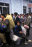 Beijing China 1990s. Unemployed migrant labour force workers queue for their trains back to their home towns in the country 1998.