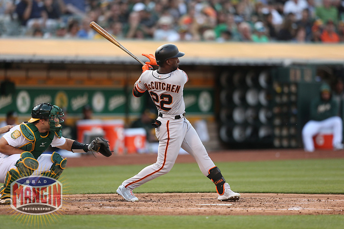 OAKLAND, CA - JULY 21:  Andrew McCutchen #22 of the San Francisco Giants bats against the Oakland Athletics during the game at the Oakland Coliseum on Saturday, July 21, 2018 in Oakland, California. (Photo by Brad Mangin)