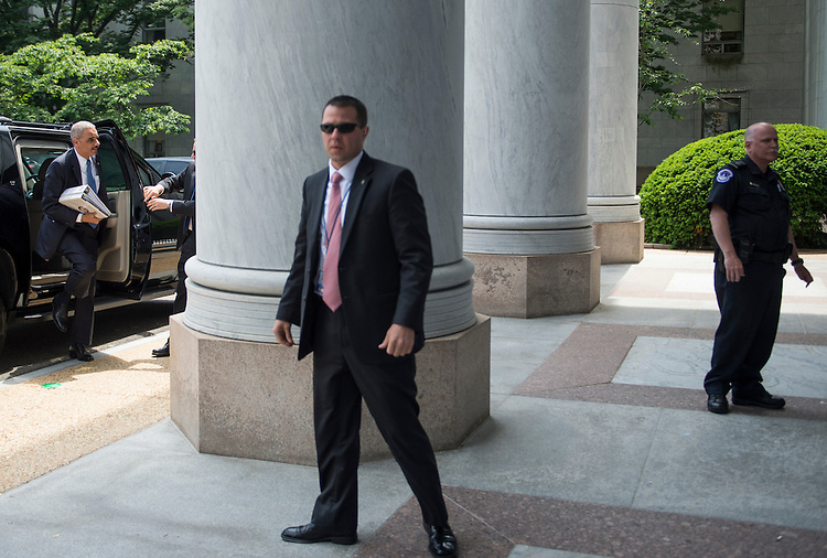"""UNITED STATES - MAY 15: Attorney General Eric Holder arrives at the Rayburn House Office Building to testify during the House Judiciary Committee hearing on """"Oversight of the United States Department of Justice"""" on Wednesday, May 15, 2013. (Photo By Bill Clark/CQ Roll Call)"""