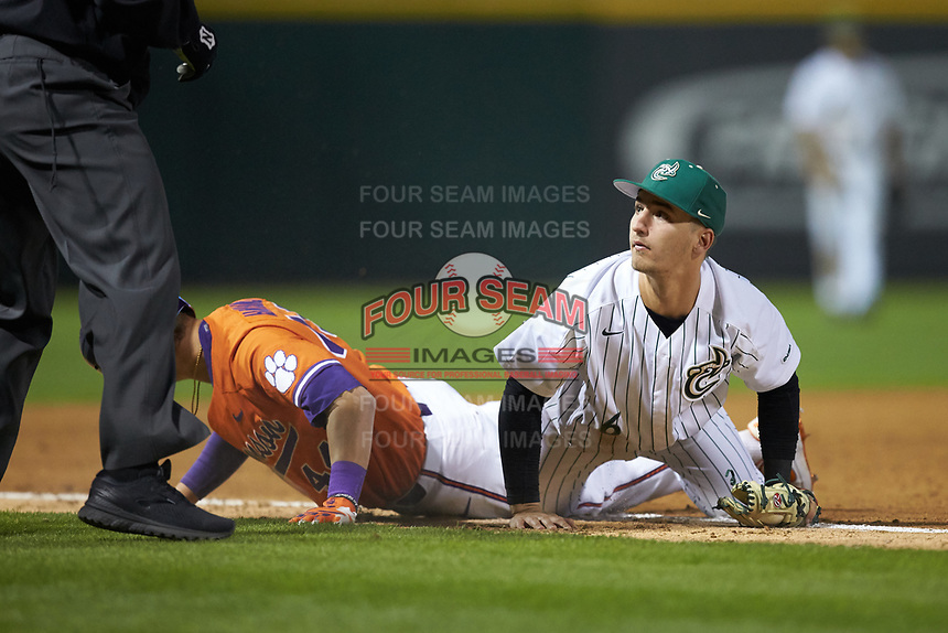 Josh Haney (6) of the Charlotte 49ers looks to the umpire for the call after attempting to tag out Bryar Hawkins (44) of the Clemson Tigers at BB&T BallPark on March 26, 2019 in Charlotte, North Carolina. The Tigers defeated the 49ers 8-5. (Brian Westerholt/Four Seam Images)