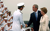 Coronado, Calif. (Aug. 30, 2005) - Commander, Naval Air Forces Pacific, Vice Adm. James Zortman, welcomes President George W. Bush and First Lady Laura Bush to Naval Air Station (NAS) North Island, Calif. President Bush visited NAS North Island to commemorate the 60th anniversary of the allied forces victory over Japan (VJ Day) during World War II. <br /> Mandatory Credit: Aaron Burden / US Navy via CNP