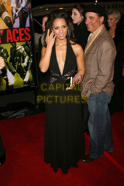 """ALICIA KEYS & ANDY GARCIA.""""Smokin' Aces"""" World Premiere - Arrivals presented by Universal Pictures and Working Title held at the Grauman's Chinese Theater, Hollywood, California, USA..January 18th, 2007.full length black dress low cut plunging neckline lace detail halterneck clutch purse jeans denim hat brown tweed jacket.CAP/ADM/ZL.©Zach Lipp/AdMedia/Capital Pictures"""