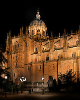 Low angle view, Cathedral, Salamanca, Spain, pictured on December 19, 2010 at night, floodlit, showing the Cupola and buttresses. Salamanca, Spain's most important University city,  has two adjoining Cathedrals, Old and New. The old Romanesque Cathedral was begun in the 12th century, and the new in the 16th century. Its style was designed to be Gothic rather than Renaissance in keeping with its older neighbour, but building continued over several centuries and a Baroque cupola was added in the 18th century. Restoration was necessary after the great Lisbon earthquake, 1755. Picture by Manuel Cohen