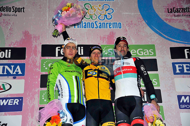 On the podium Gerald Ciolek (GER) MTN-Qhubeka winner, Peter Sagan (SVK) Cannondale in 2nd place and Fabian Cancellara (SUI) Radioshack-Trek, at the end of the 2013 Milan-San Remo race, the race was shortened due to snow. 17th March 2013.     <br /> Photo: Gian Mattia D'Alberto/LaPresse/www.newsfile.ie