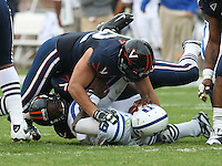 Duke quarterback Thaddeus Lewis (9) is sacked by Virginia defensive end Zane Parr (92) \during an ACC football game Saturday in Charlottesville, VA. Duke won 28-17. Photo/Andrew Shurtleff