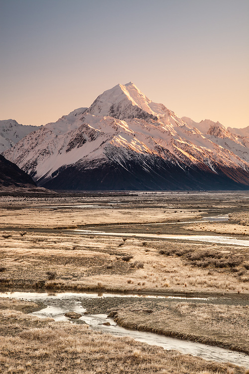 Winter sunrise looking up the Tasman Valley towards Aoraki / Mt Cook covered in snow. Mackenzie Country, Canterbury, New Zealand - stock photo, canvas, fine art print