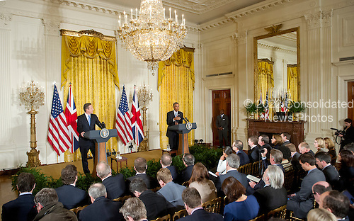United States President Barack Obama, right, and Prime Minister David Cameron of the United Kingdom, left, hold a joint press conference in the East Room of the White House in Washington, D.C. on Friday, January 16, 2015. During the course of the press conference the leaders touched on issues such as cybersecurity, terrorism, ISIL and the economy.<br /> Credit: Ron Sachs / Pool via CNP