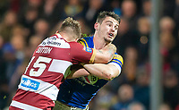 Picture by Allan McKenzie/SWpix.com - 13/04/2018 - Rugby League - Betfred Super League - Leeds Rhinos v Wigan Warriors - Headingley Carnegie Stadium, Leeds, England - Stevie Ward is tackled by Ryan Sutton.