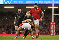 Wales' Jonah Holmes is tackled by Tonga's Atieli Pakalani<br /> <br /> Photographer Ian Cook/CameraSport<br /> <br /> Under Armour Series Autumn Internationals - Wales v Tonga - Saturday 17th November 2018 - Principality Stadium - Cardiff<br /> <br /> World Copyright © 2018 CameraSport. All rights reserved. 43 Linden Ave. Countesthorpe. Leicester. England. LE8 5PG - Tel: +44 (0) 116 277 4147 - admin@camerasport.com - www.camerasport.com