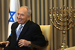 "Israeli President Shimon Peres speaks to the press at the official submission of the Bank of Israel report by the Bank of Israel Governor, Stanley Fischer, at the Presidential Residence in Jerusalem, Sunday, April 19, 2009. Stanley Fischer declared that ""the report says we are dealing with the current crisis relatively well"", although he did stress that he expects the decline to continue and that he believes that the Israeli economy has yet to reach its lowest point. Photo By: Emil Salman / JINI"