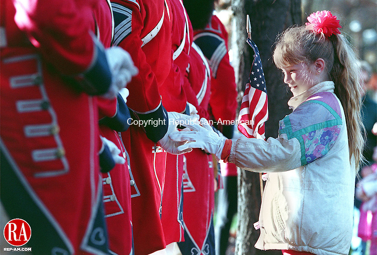 NAUGATUCK,CT-11/11/98-1111CK01.tif-Janet Morcaldi age 8 stands behind her father Arthur playing with his hands as he stands at attention during the Veterens Day ceremony on the Naugatuck on Wednesday.   CASEY KEIL PHOTO.