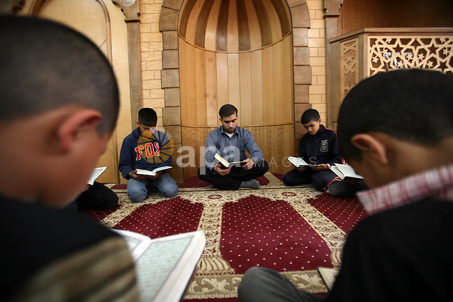 Palestinian orphan children read Qur'an at the Hebron's orphan house, in the West Bank city of Hebron 24 May 2012.  Hebron's orphan house  contain about 100 orphan children from ages 6 to 18 years old, and oversees some of orphans in their houses. Photo by Mamoun Wazwaz