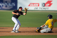 Christian Stringer (9) of the Kannapolis Intimidators waits for the ball as Cole Tucker (2) of the West Virginia Power slides into second base at CMC-Northeast Stadium on April 21, 2015 in Kannapolis, North Carolina.  The Power defeated the Intimidators 5-3 in game one of a double-header.  (Brian Westerholt/Four Seam Images)