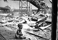 This terrified baby was almost the only human being left alive in Shanghai's South Station after brutal Japanese bombing.  China, August 28, 1937.  H.S. Wong. (OWI)<br /> NARA FILE #:  208-AA-132N-2<br /> WAR &amp; CONFLICT BOOK #:  1131