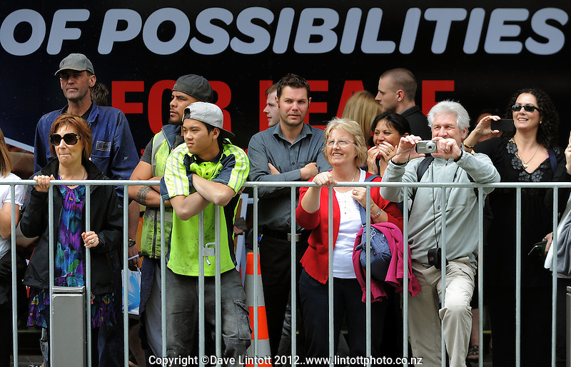 Fans watch from behind barriers during the 2012 Wellington IRB sevens parade in the Wellington CBD, Wellington, New Zealand on Thursday, 2 February 2012. Photo: Dave Lintott / lintottphoto.co.nz