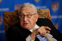 Henry Kissinger answers a reporter's question during a media roundtable to announce that Henry Kissinger will be part of the USA Bid Committee to host the FIFA World Cup at the Waldorf-Astoria Hotel in New York, NY, on March 30, 2009. Photo by Howard C. Smith/isiphotos.com