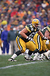 GREEN BAY, WI - NOVEMBER 19:  Mark Tauscher #65 of the Green Bay Packers moves off the line during the game against the Baltimore Colts at Lambeau Field on November 19,2000 in Green Bay, Wisconsin. The Packers won 26-24. ( Photo by: David Stluka/Getty Images) *** Local Caption *** Mark Tauscher