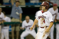 South Carolina's Robert Beary scores a run in Game 10 of the NCAA Division One Men's College World Series on June 24th, 2010 at Johnny Rosenblatt Stadium in Omaha, Nebraska.  (Photo by Andrew Woolley / Four Seam Images)