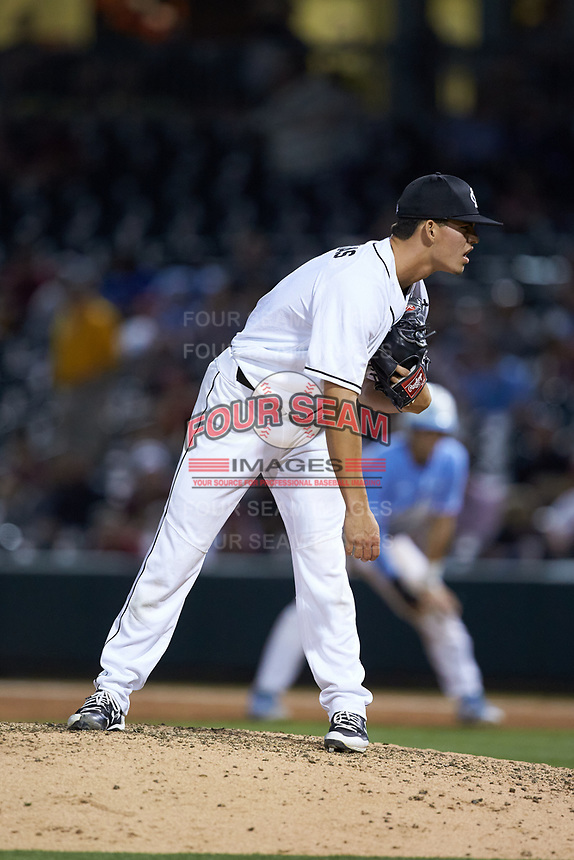 South Carolina Gamecocks relief pitcher Eddy Demurias (9) looks to his catcher for the sign against the North Carolina Tar Heels at BB&T BallPark on April 3, 2018 in Charlotte, North Carolina. The Tar Heels defeated the Gamecocks 11-3. (Brian Westerholt/Four Seam Images)