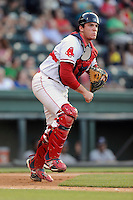 Catcher Jordan Procyshen (17) of the Greenville Drive makes a play to first base in a game against the Rome Braves on Monday, June 15, 2015, at Fluor Field at the West End in Greenville, South Carolina. Greenville won, 9-3. (Tom Priddy/Four Seam Images)