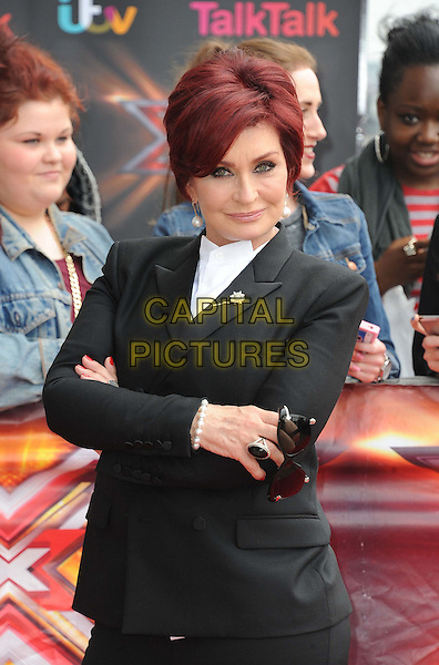Sharon Osbourne<br /> Arrivals for The X Factor at London Excel, London, England.<br /> 19th June 2013<br /> half length black suit blazer arms crossed <br /> CAP/ROS<br /> &copy;Steve Ross/Capital Pictures
