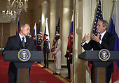 Washington, D.C. - September 16, 2005 -- United States President George W. Bush, right, and President Vladimir Putin of the Russian Federation, left, hold a joint press conference in the East Room of the White House in Washington, D.C. on September 16, 2005 after their bi-lateral talks.<br /> Credit: Ron Sachs / CNP