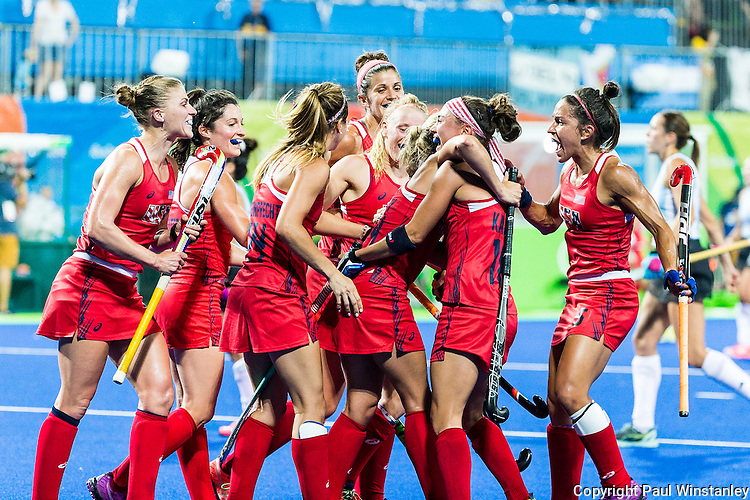 USA teammates celebrate after scoring the first goal of Argentina vs USA in a Pool B game at the Rio 2016 Olympics at the Olympic Hockey Centre in Rio de Janeiro, Brazil.