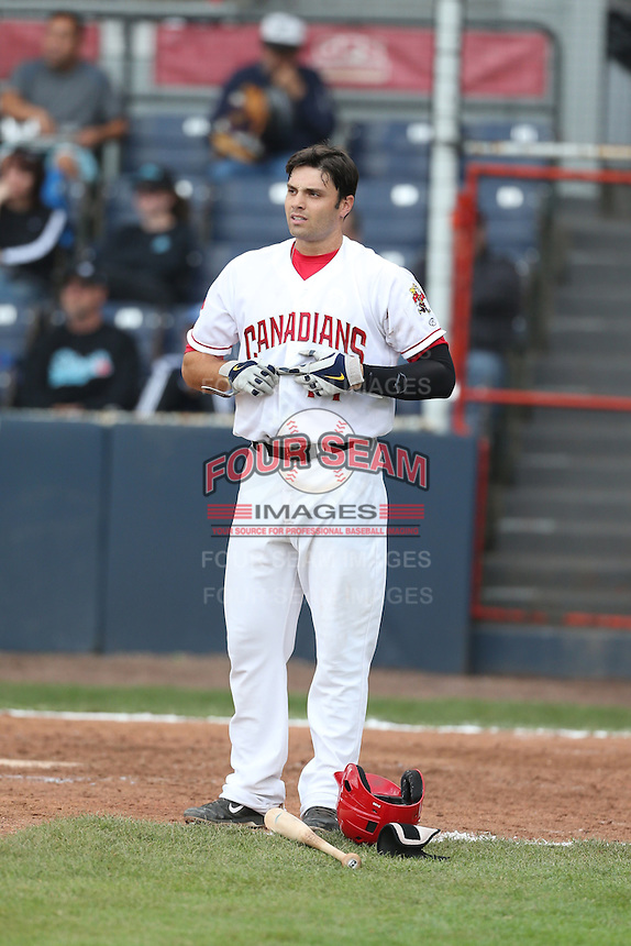Ryan McBroom #14 of the Vancouver Canadians after batting against against the Hillsboro Hops at Nat Bailey Stadium on July 24, 2014 in Vancouver, British Columbia. Hillsboro defeated Vancouver, 7-3. (Larry Goren/Four Seam Images)