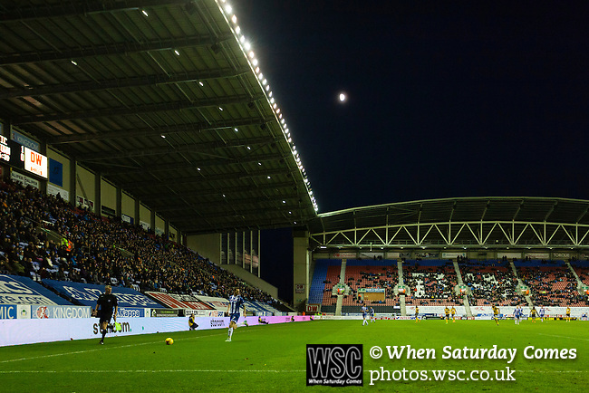 Wigan Athletic 1 Shrewsbury Town 0, 21/11/2015. DW Stadium, League One. The DW Stadium. Wigan Athletic earned a narrow 1-0 at home to Shrewsbury Town. Wigan competed in the Premier League from 2005 to 2013. They won the 2013 FA Cup. The club also embarked on its first European campaign during the 2013–14 UEFA Europa League. The Moon rising behind the East Stand of The DW Stadium.  Photo by Paul Thompson