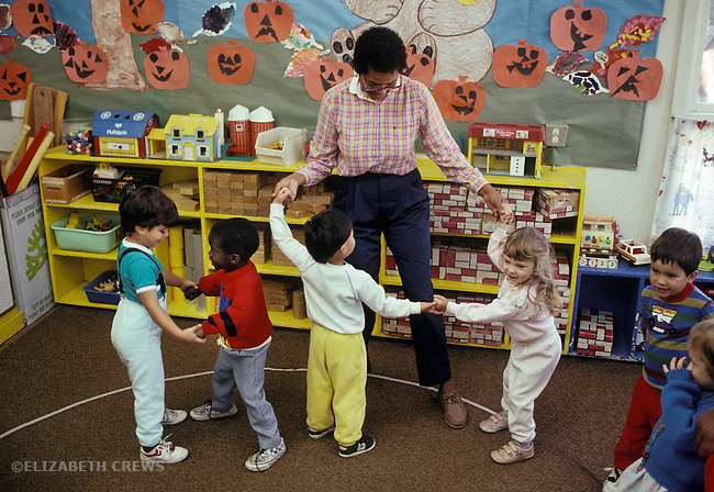 Albany CA Three-year-old preschoolers dancing with teacher at day care