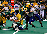FARGO, ND - NOVEMBER 22th, 2008 : Tyler Roehl, North Dakota State running back is brought to a stop by South Dakota State's Chris Johnson and Conrad Kjerstad in the first quarter during their game Saturday evening at the Fargodome on the campus of North Dakota State University in Fargo, ND. (Photo By Ty Carlson/Inertia)