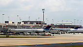 A group of Delta airlines sitting on the tarmac at   Atlanta Hartsfield-Jackson International Airport (ATL) in Atlanta, Georgia on Sunday October 2, 2005. The Atlanta based airlines filed for bankruptcy on Wednesday September 14, 2005, citing rising fuel costs $60 - $70 per barrel) and high cost structures in a low-fare world. Photo by Jane Therese/Sipa