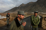 Three Afghan National policemen man a checkpoint in late December 2008 on the outskirts of Kabul on a road leading towards nearby provinces frequently cited in reports as being increasingly in the hands of the Taliban.