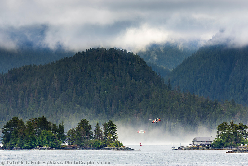 Coast Guard Helicopters practice rescue maneuvers in the island waters of Sitka, Alaska
