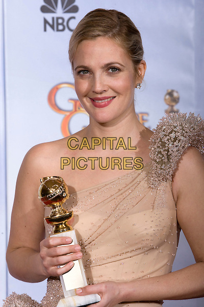 """DREW BARRYMORE - BEST PERFORMANCE BY AN ACTRESS IN A MINI-SERIES OR MOTION PICTURE MADE FOR TELEVISION for her work in """"Grey Gardens"""".at the 67th Annual Golden Globe Awards at the Beverly Hilton in Beverly Hills, CA, USA, January 17th 2010..Globes pressroom press room half length award trophy smiling peach beige one shoulder flesh dress beaded sheer see thru through .CAP/AW/HFPA.Supplied by Anita Weber/Capital Pictures."""